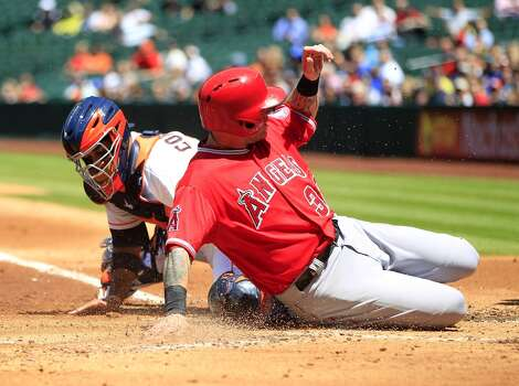 April 7: Angels 9, Astros 1  The Halos made frequent trips home in the series finale.  Record: 3-4. Photo: Karen Warren, Houston Chronicle