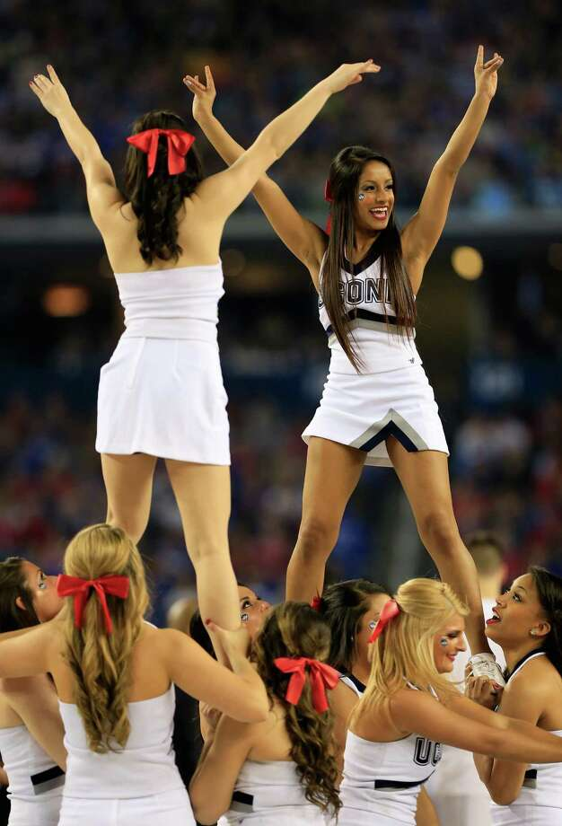 ARLINGTON, TX - APRIL 07: Connecticut Huskies cheerleaders perform during the NCAA Men's Final Four Championship against the Kentucky Wildcats at AT&T Stadium on April 7, 2014 in Arlington, Texas. Photo: Jamie Squire, Getty Images / 2014 Getty Images
