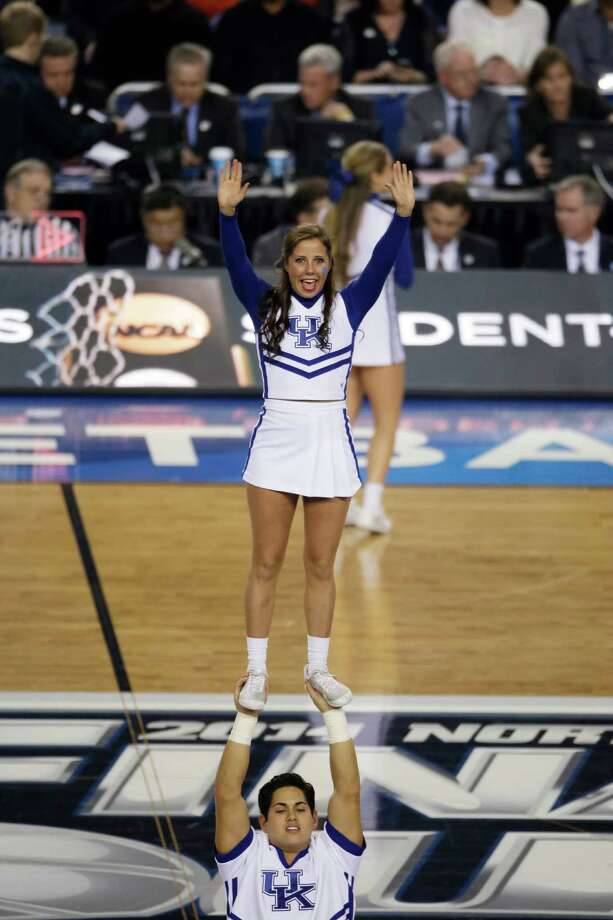 Kentucky cheerleaders perform during the first half of the NCAA Final Four tournament college basketball championship game against Connecticut Monday, April 7, 2014, in Arlington, Texas. (AP Photo/Tony Gutierrez) Photo: Tony Gutierrez, Associated Press / AP