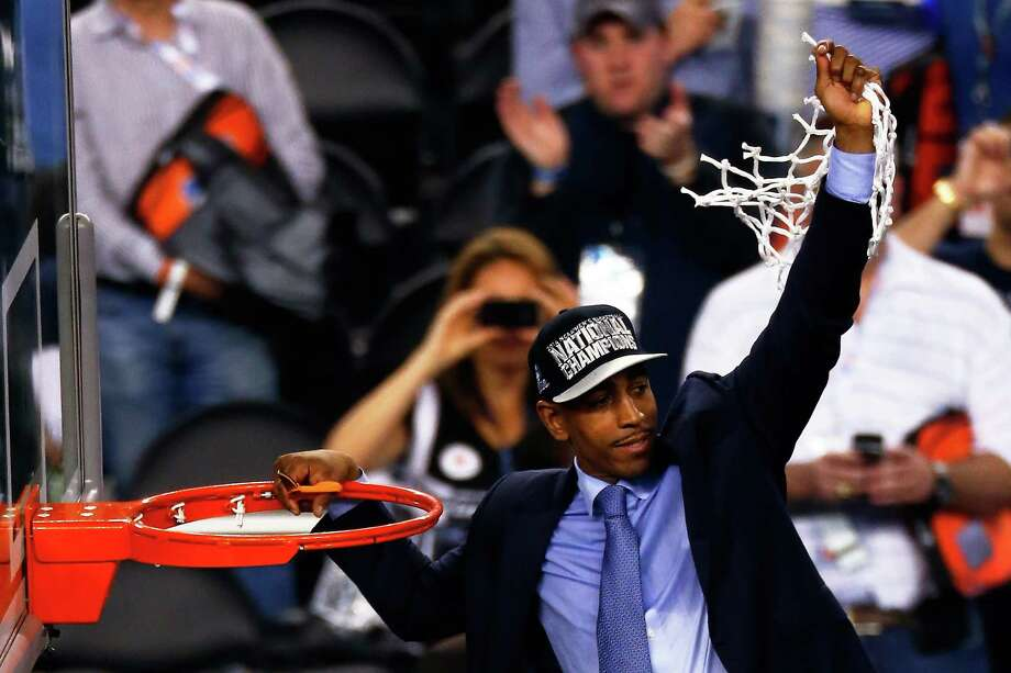 ARLINGTON, TX - APRIL 07:  Head coach Kevin Ollie of the Connecticut Huskies cuts down the net after defeating the Kentucky Wildcats 60-54 in the NCAA Men's Final Four Championship at AT&T Stadium on April 7, 2014 in Arlington, Texas. Photo: Tom Pennington, Getty Images / 2014 Getty Images