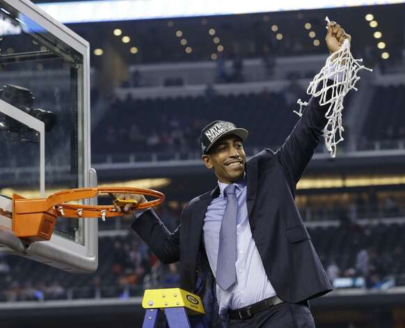 Connecticut head coach Kevin Ollie cuts down the net after his team's 60-54 victory over Kentucky in the NCAA Final Four tournament college basketball championship game Monday, April 7, 2014, in Arlington, Texas. (AP Photo/David J. Phillip) Photo: AP