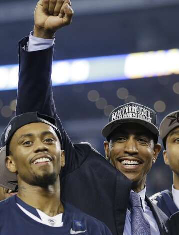 Connecticut head coach Kevin Ollie, right, celebrates with his team after their 60-54 victory over Kentucky in the NCAA Final Four tournament college basketball championship game Monday, April 7, 2014, in Arlington, Texas. (AP Photo/David J. Phillip) Photo: AP