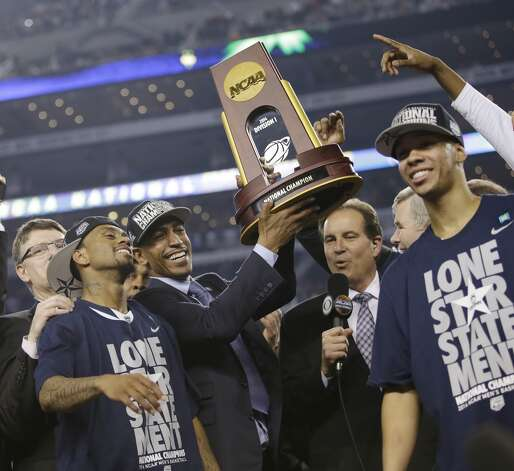 Connecticut head coach Kevin Ollie, center, celebrates with his team after their 60-54 victory over Kentucky in the NCAA Final Four tournament college basketball championship game Monday, April 7, 2014, in Arlington, Texas. (AP Photo/David J. Phillip) Photo: AP