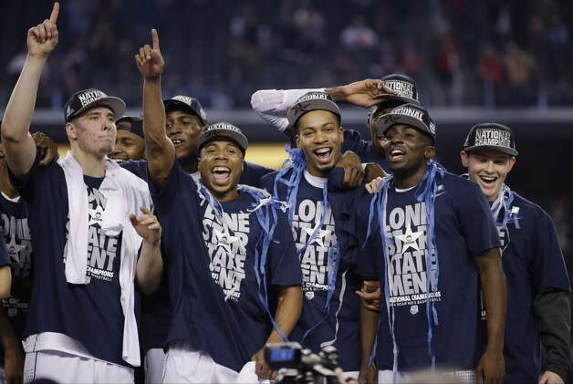 Connecticut players celebrate after their 60-54 victory over Kentucky in the NCAA Final Four tournament college basketball championship game Monday, April 7, 2014, in Arlington, Texas. (AP Photo/David J. Phillip) Photo: AP