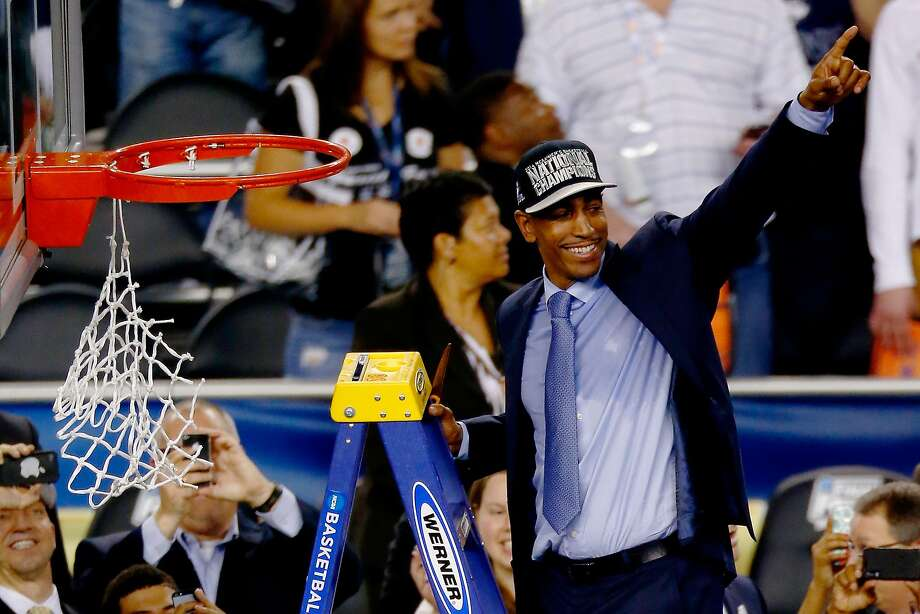 Kevin Ollie acknowledges Connecticut fans after netting a national basketball championship in just his second season as head coach of the Huskies. Photo: Tom Pennington, Getty Images