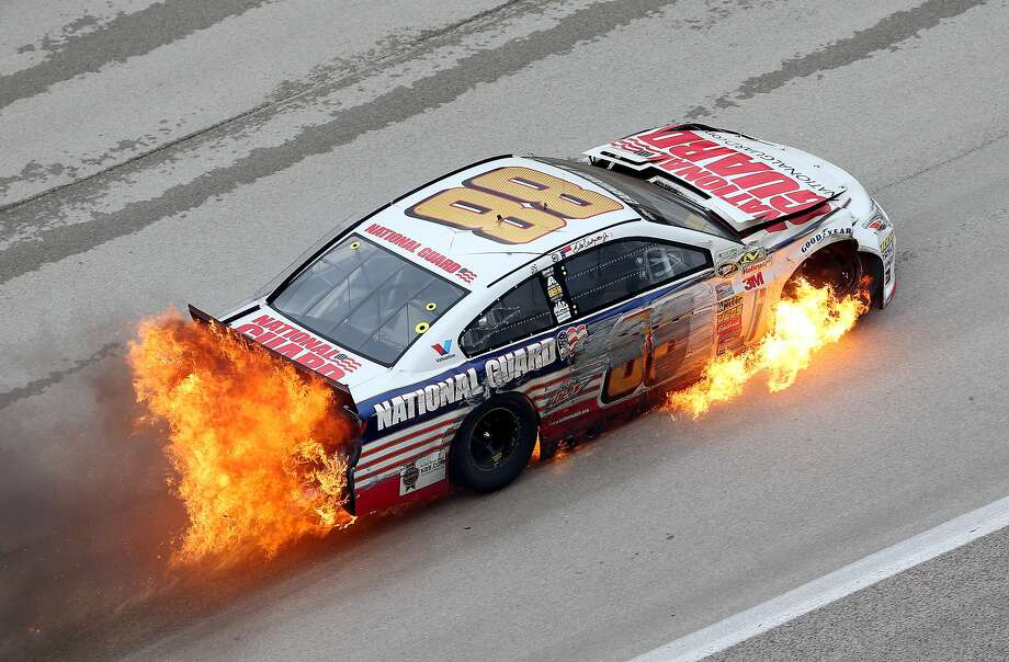 Texas toast:Dale Earnhardt Jr.'s Chevrolet catches fire after crashing early in the NASCAR Sprint Cup Series Duck Commander 500 at Texas Motor Speedway in Fort Worth. He scrambled out of the car unharmed. Photo: Nick Laham, Getty Images