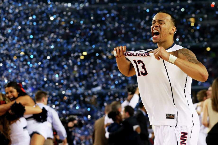 Connecticut's Shabazz Napier reminded everyone at AT&T Stadium on Monday which team had just won the 2014 NCAA Tournament. Photo: Ronald Martinez, Staff / 2014 Getty Images