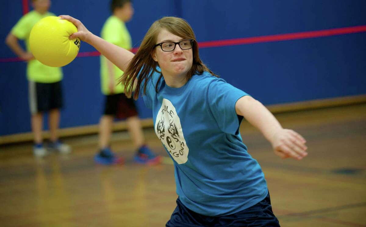"""Lucy Grant, 13, in 8th grade, gets ready to throw a ball during the 8th annual Tiger Ball event, at Bethel Middle School on Monday, April 7, 2014. Tiger Ball is a multiple team dodgeball competition that the Bethel, Conn, school has been holding for the last eight years. Grant's team is called the """"Doble Dragons"""". The event raised money for the Scotty Fund charity in Bethel."""