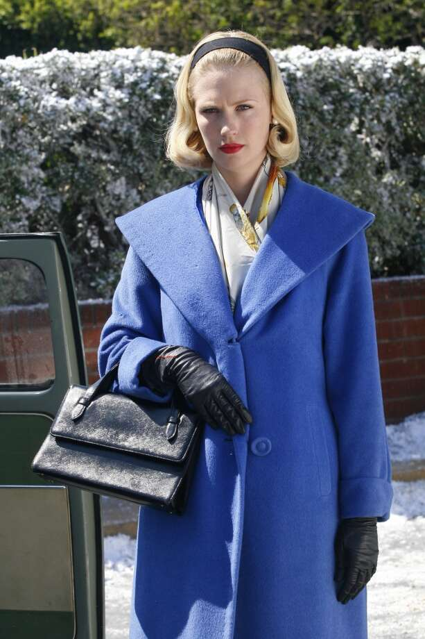 Fashion: The '50s are still felt with full skirts, swing coats, capri pants, pearls and coiffed hair a la Grace Kelly. (AMC)