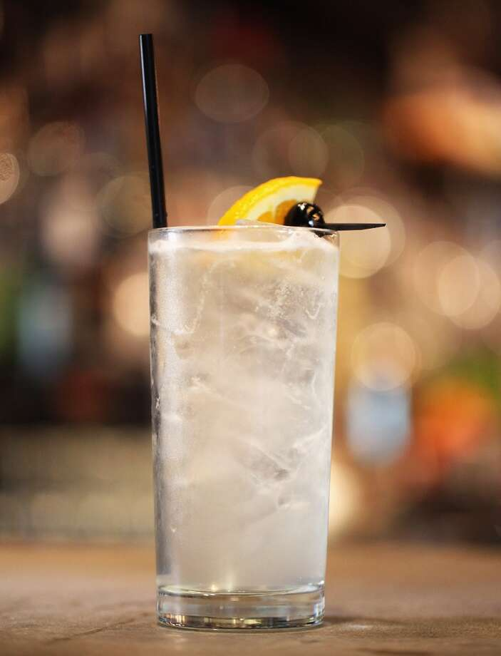 Drink: Don Draper shows daughter Sally how to properly mix a Tom Collins. (Getty Images) Photo: Boston Globe, Boston Globe Via Getty Images