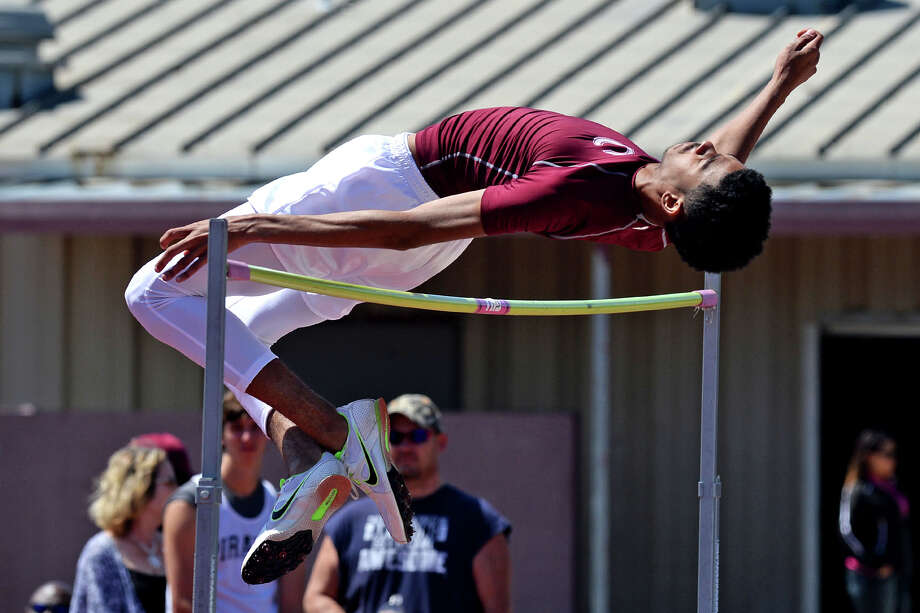 Central's Andrew Wells competes in the high jump during a track meet at the Jaguar's stadium on Monday. 