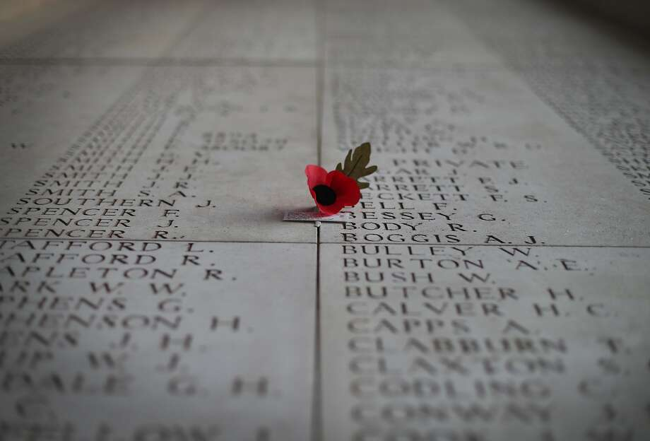 A poppy flower sits on a panel showing some of the names of the 54407 identified casualties at the Menin Gate Memorial to the Missing in Ypres, Belgium. A number of events will be held this year to commemorate the centenary of the start of World War One. Photo: Peter Macdiarmid, Getty Images