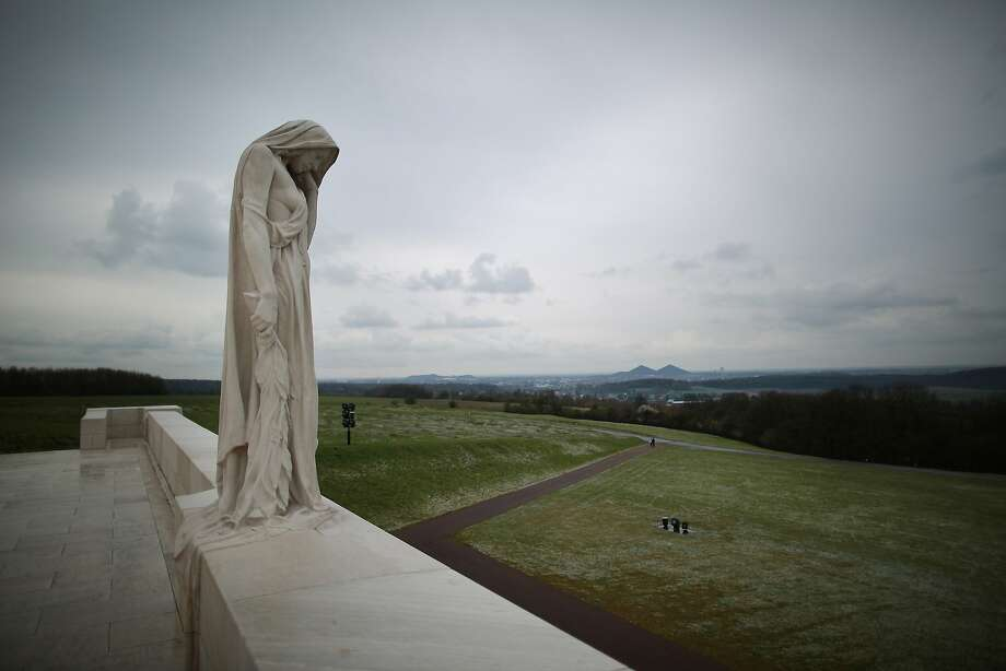 A sculpture titled 'Mother Canada' looks out from the Canadian National Vimy Memorial in Vimy, France. A number of events will be held this year to commemorate the centenary of the start of World War One. Photo: Peter Macdiarmid, Getty Images