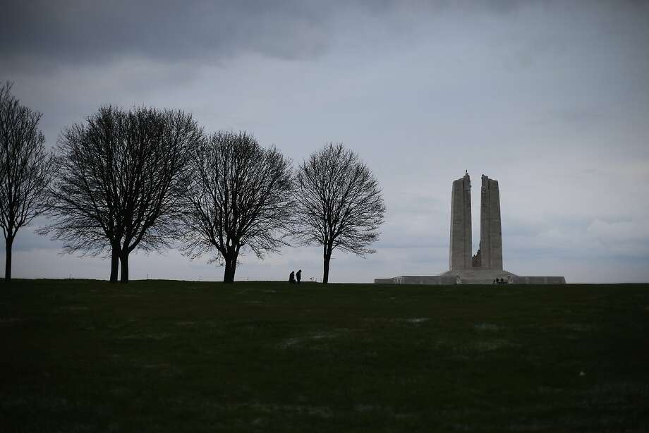 Visitors walk along a tree lined path to the Canadian National Vimy Memorial in Vimy, France. A number of events will be held this year to commemorate the centenary of the start of World War One. Photo: Peter Macdiarmid, Getty Images