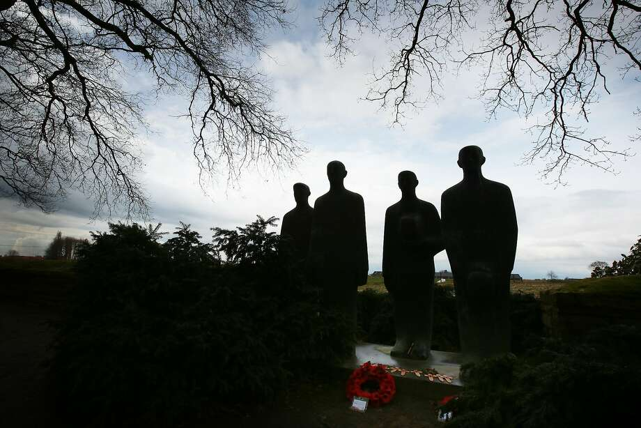 A bronze sculpture of four figures by Emil Krieger is silhouetted against a Flanders sky at the German Langemark cemetery in Poelkapelle, Belgium. A number of events will be held this year to commemorate the centenary of the start of World War One. Photo: Peter Macdiarmid, Getty Images