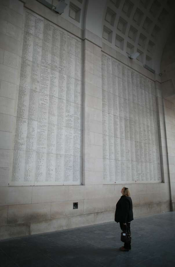 A visitor looks at panels containing the names of some of the 54407 identified casualties at the Menin Gate Memorial to the Missing in Ypres, Belgium. A number of events will be held this year to commemorate the centenary of the start of World War One. Photo: Peter Macdiarmid, Getty Images