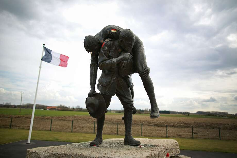 Peter Corlett's 'Cobbers' sculpture is displayed at V.C. Corner Australian Memorial in Fromelles, France. A number of events will be held this year to commemorate the centenary of the start of World War One. Photo: Peter Macdiarmid, Getty Images