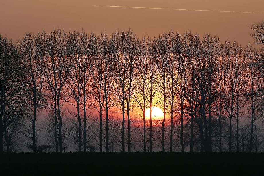The sun sets over the Somme battlefields near Beaumont-Hamel, France. A number of events will be held this year to commemorate the centenary of the start of World War One. Photo: Peter Macdiarmid, Getty Images