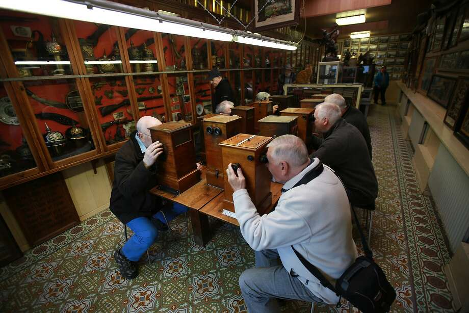 Visitors to Sanctuary Wood Museum Hill 62 look at World War One  stereoscopic archive photographs near Ypres, Belgium. A number of events will be held this year to commemorate the centenary of the start of World War One. Photo: Peter Macdiarmid, Getty Images