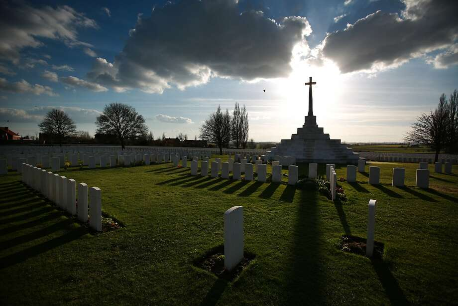 The Cross of Sacrifice is silhouetted by early evening sunshine at Tyne Cot Commonwealth War Graves Commission cemetery in Passchendaele, Belgium. Tyne Cot is the largest Commonwealth war cemetery in the world. There are 11,956 Commonwealth servicemen of the First World War buried or commemorated here. A number of events will be held this year to commemorate the centenary of the start of World War One. Photo: Peter Macdiarmid, Getty Images