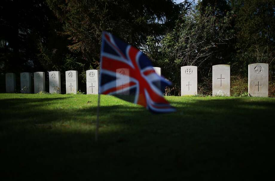 A Union flag flutters in front of graves of British soldiers at the Commonwealth War Graves Commission cemetery in Saint Symphorien, Belgium. A number of events will be held this year to commemorate the centenary of the start of World War One. Photo: Peter Macdiarmid, Getty Images