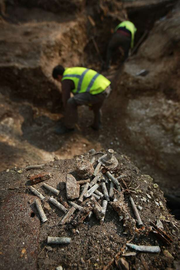 Battlefield artifacts are collected as members of the Somme Association restore World War One trenches at Thiepval Wood, France. A number of events will be held this year to commemorate the centenary of the start of World War One. Photo: Peter Macdiarmid, Getty Images