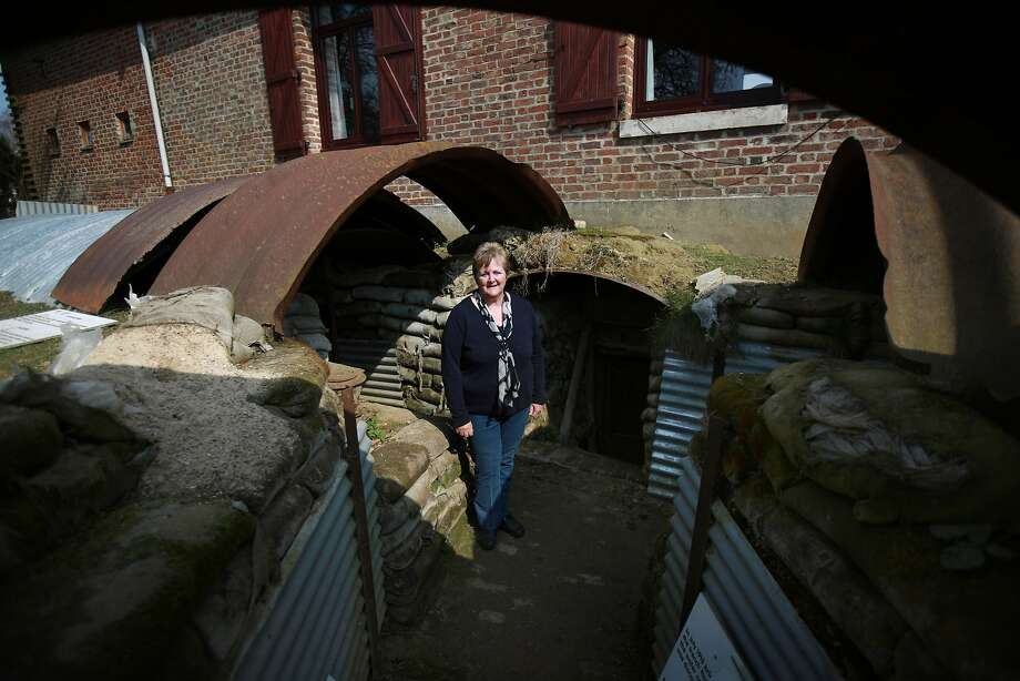 Guest house owner Avril Williams stands in a restored Somme Battlefield trench in the back garden of her guest house in Auchonvillers, France. A number of events will be held this year to commemorate the centenary of the start of World War One. Photo: Peter Macdiarmid, Getty Images