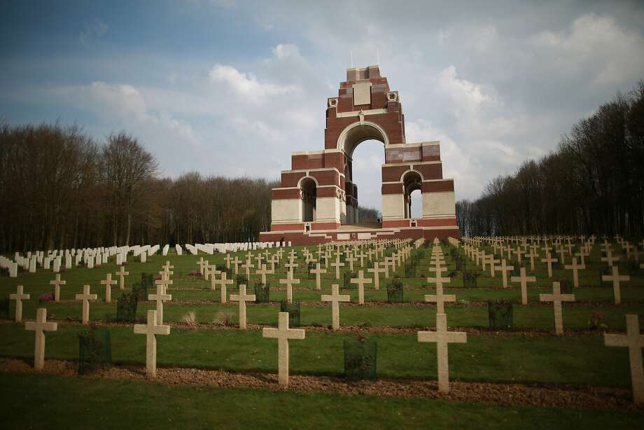 Commonwealth (L) and French (R) graves are marked out in front of the Thiepval Memorial to the Missing of the Somme in Thiepval, France. A number of events will be held this year to commemorate the centenary of the start of World War One. Photo: Peter Macdiarmid, Getty Images