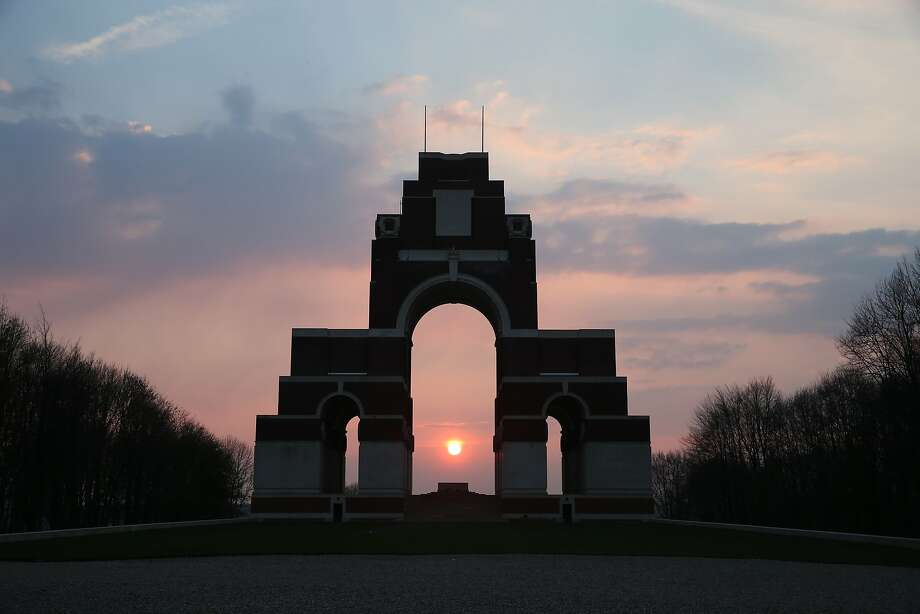 The setting sun is glimpsed through the central arch of the  Thiepval Memorial to the Missing of the Somme in Thiepval, France. A number of events will be held this year to commemorate the centenary of the start of World War One. Photo: Peter Macdiarmid, Getty Images