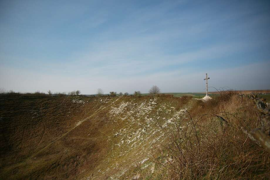 A cross stands on the edge of the Lochnagar Crater on in La Boisselle, France. The crater was made when a huge mine was detonated on the first day of the Somme offensive during World War One on July 1, 2016. A number of events will be held this year to commemorate the centenary of the start of World War One. Photo: Peter Macdiarmid, Getty Images
