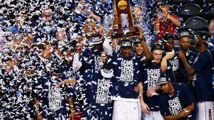 ARLINGTON, TX - APRIL 07: DeAndre Daniels #2 of the Connecticut Huskies holds up the trophy after defeating the Kentucky Wildcats 60-54 in the NCAA Men's Final Four Championship at AT&T Stadium on April 7, 2014 in Arlington, Texas.  (Photo by Tom Pennington/Getty Images)