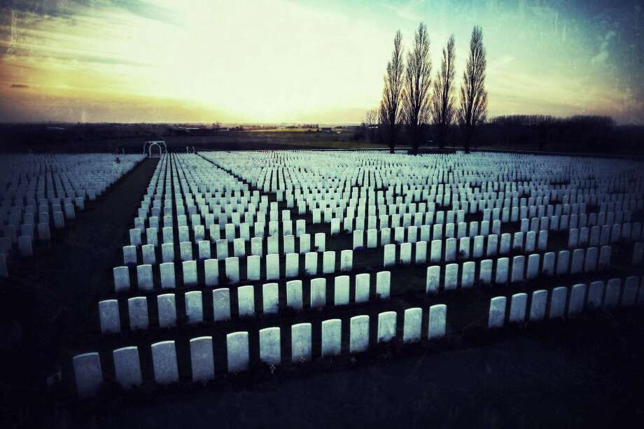 Rows of headstones are bathed in late afternoon sunshine at Tyne Cot Commonwealth War Graves Commission cemetery on March 24, 2014 in Passchendaele, Belgium. Tyne Cot is the largest Commonwealth war cemetery in the world. There are 11,956 Commonwealth servicemen of the First World War buried or commemorated here. A number of events will be held this year to commemorate the centenary of the start of World War One. Photo: Peter Macdiarmid, Getty Images / 2014 Getty Images