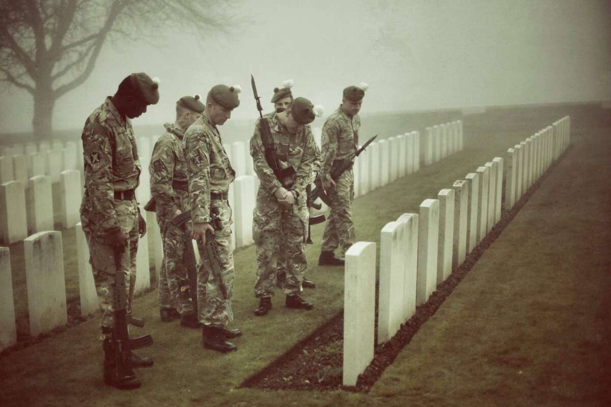 Soldiers of The 2nd Battalion The Royal Regiment of Scotland look at headstones as they rehearse for a re-burial ceremony in Loos British Cemetery in Loos-en-Gohelle, France. Almost 100 years after they were killed in action in the World War One battle of Loos in 1915, twenty British soldiers will be re-interred in the Commonwealth War Graves Commission Loos British Cemetery in Northern France. Private William McAleer, from the 7th Battalion the Royal Scottish Fusiliers, was found with his identity disc, but others found him remain unidetified and will be buried as soldiers 'Known unto God'. However, among the other soldiers are a Northumberland Fusilier, a further six Royal Scottish Fusiliers, a member of the York and Lancaster Regiment, two Queens Own Cameron Highlanders and nine others for whom no regiment has been identified.