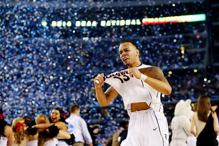 Shabazz Napier #13 of the Connecticut Huskies celebrates on the court after defeating the Kentucky Wildcats 60-54 in the NCAA Men's Final Four Championship at AT&T Stadium on April 7, 2014 in Arlington, Texas. Photo: Ronald Martinez, Getty Images