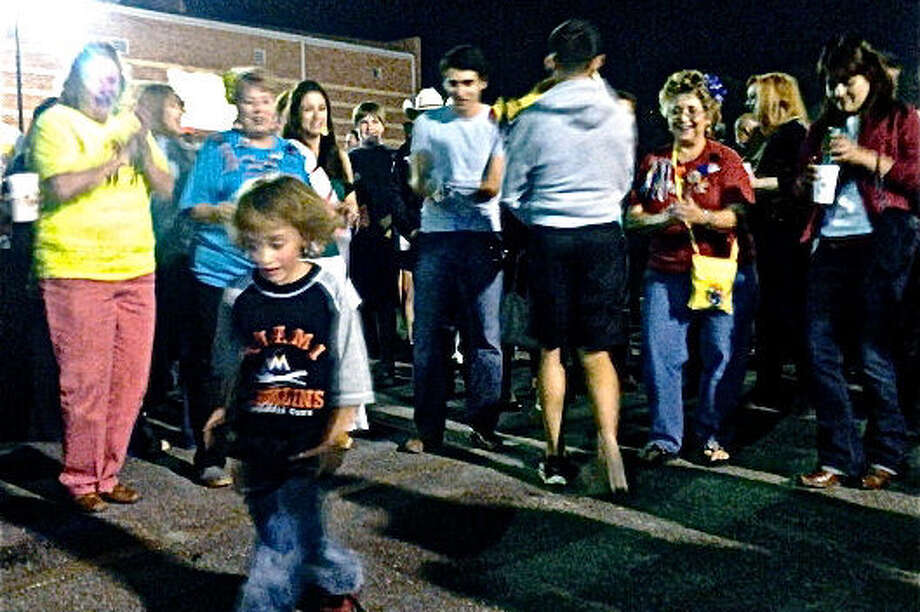Howard Early Childhood Center student Jack Gregston shows off his dance moves to a delighted crowd at the 2013 Alamo Heights Night at the University of the Incarnate Word. Photo: File Photo