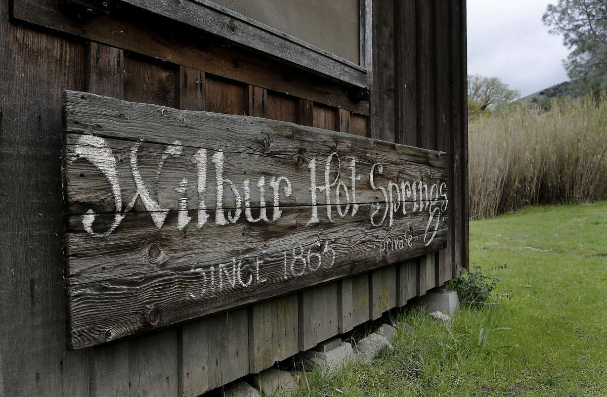 An old weathered sign that used to hang above the front door of the lodge now rests on a nearby building, on Friday April 4, 2014, near Williams, Calif. The owners and employees of Wilbur Hot Springs, the historic and beloved hot springs in Colusa County, are still mopping up and accessing the damage after the old lodge was destroyed by a fire last weekend.