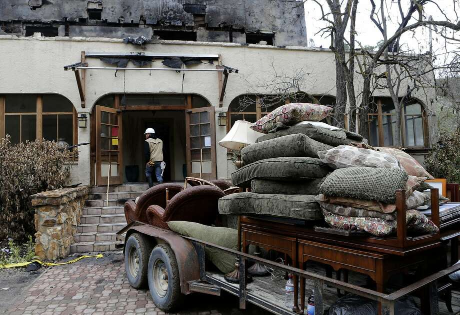 Oscar Pineda helps recover some of the salvaged furnishings from the lodge at Wilbur Hot Springs after it was destroyed in a fire in March. Photo: Michael Macor, The Chronicle