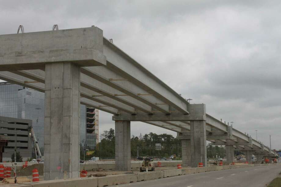 The main supporting beams of reinforced concrete were placed along the northbound frontage road of Interstate 45 during the weekend of March 28.  Frontage roads were closed at that time but have now been reopened. Photo: Zachry-Odebrecht Parkway Builder
