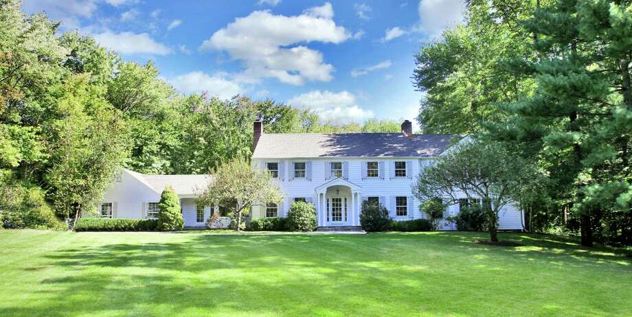 Placed on three acres of back-country oasis, the Colonial at 722 Hollow Tree Ridge Road in Darien is surrounded by meadowlands in a park-like setting in the Five Mile River area. It is on the market for  $2,495,000. Photo: Contributed Photo, Contributed / Darien News