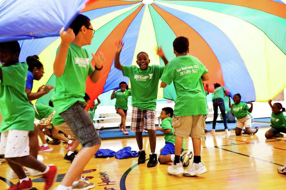 The YMCA of Greater Houston offers affordable day camps throughout the city that provide supervised activities to youth, ages 5-10, that teach core values, conflict resolution and leadership skills. / KENNON EVETT