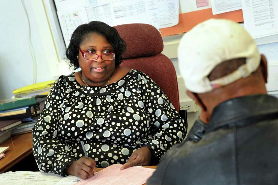 Site coordinator Wanda Wilson assists a client with tax preparation on Tuesday, March 18, 2014, at Trinity Alliance in Albany, N.Y. (Cindy Schultz / Times Union) Photo: Cindy Schultz / 00026151A