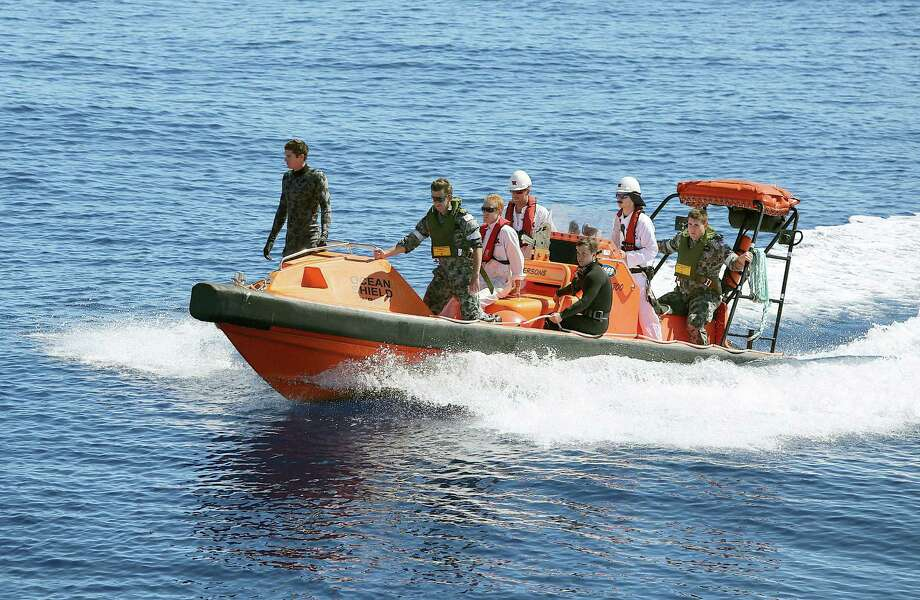 In this April 7, 2014 photo provided by the Australian Defense Force a fast response craft manned by members from the Australian Defense's ship Ocean Shield is deployed to scan the water for debris of missing Malaysia Airlines Flight 370 in the southern Indian Ocean. Up to 14 planes and as many ships were focusing on a single search area covering 77, 580 square kilometers (29,954 square miles) of ocean, 2,270 kilometers (1,400 miles) northwest of the Australian west coast city of Perth, Australia. Photo: LSIS Bradley Darvill, AP / Australian Defense Force