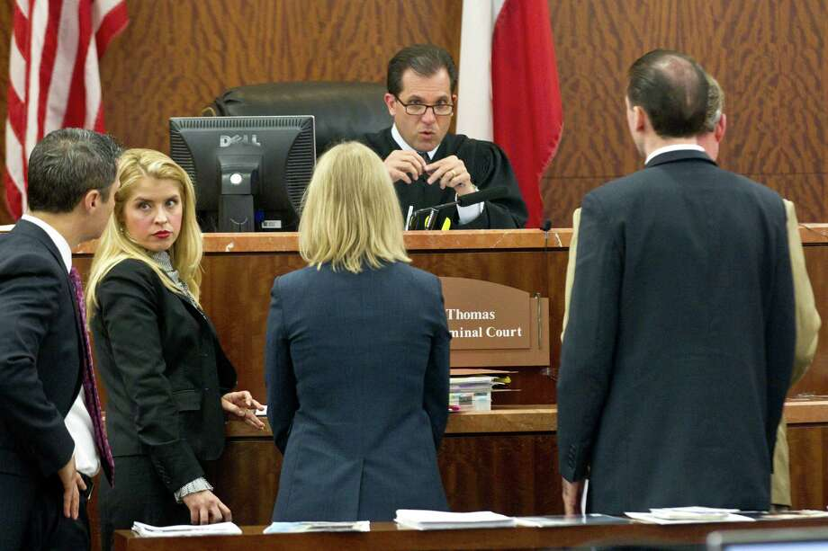 Judge Brock Thomas talks to the attorneys in the trial against Ana Lilia Trujillo Tuesday, April 8, 2014, in Houston. Trujillo, 45, is charged with murder, accused of killing her 59-year-old boyfriend, Alf Stefan Andersson with the heel of a stiletto shoe, at his Museum District high-rise condominium in June 2013. Photo: Brett Coomer, Houston Chronicle / © 2014 Houston Chronicle