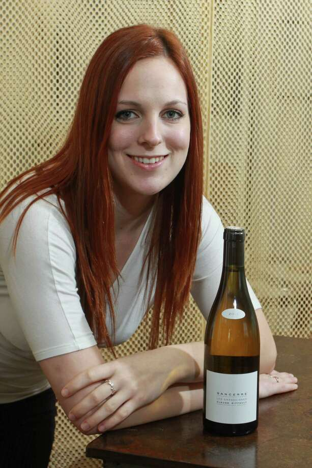 (For the Chronicle/Gary Fountain, April 2, 2014) Wine director, Stephanie Perkins in the lounge of Triniti Restaurant and Bar, with her wine of choice, Claude Riffault Sancerre 2011. Photo: Gary Fountain, Freelance / Copyright 2014 by Gary Fountain