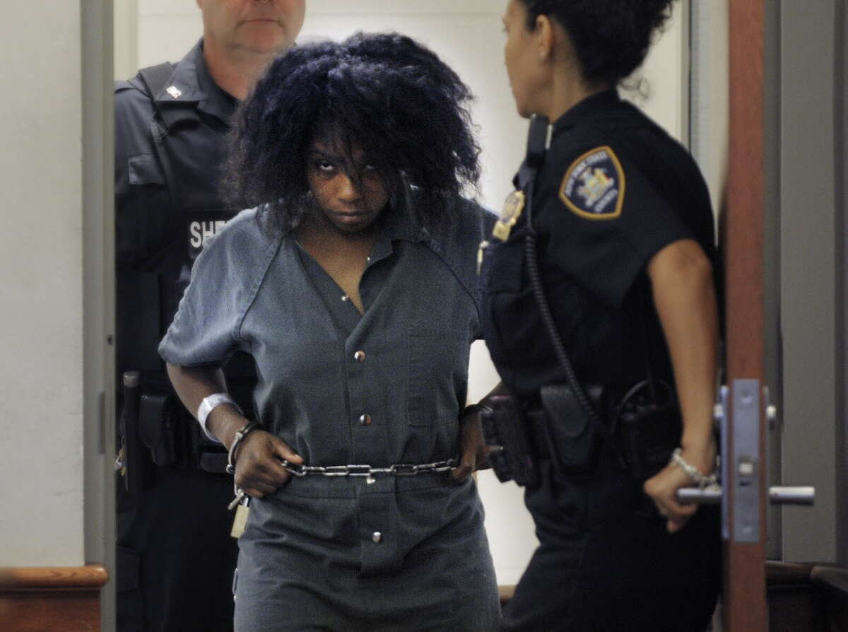 Audrea Gause is brought into Troy City Court on Tuesday, July 23, 2013 in Troy, NY. Audrea Gause is accused of trying to steal $480,000 from the fund for victims of the Boston marathon bombing. (Paul Buckowski / Times Union archive)