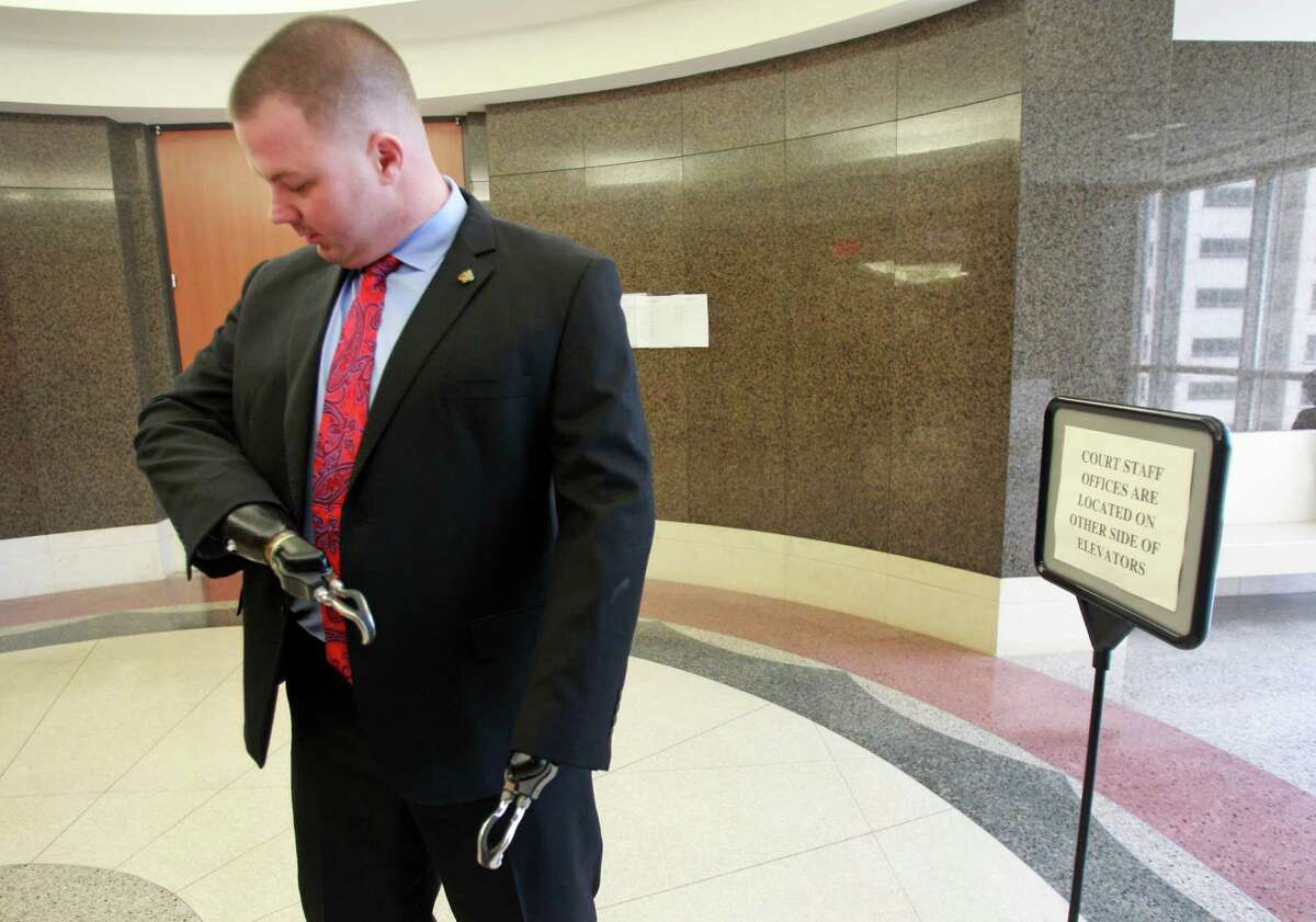 Former United States Marine Eddie Wright talks outside the Probate Civil Court No. 4 at the Civil Courthouse Tuesday, March 25, 2014, in Houston. He has a home from Helping a Hero.
