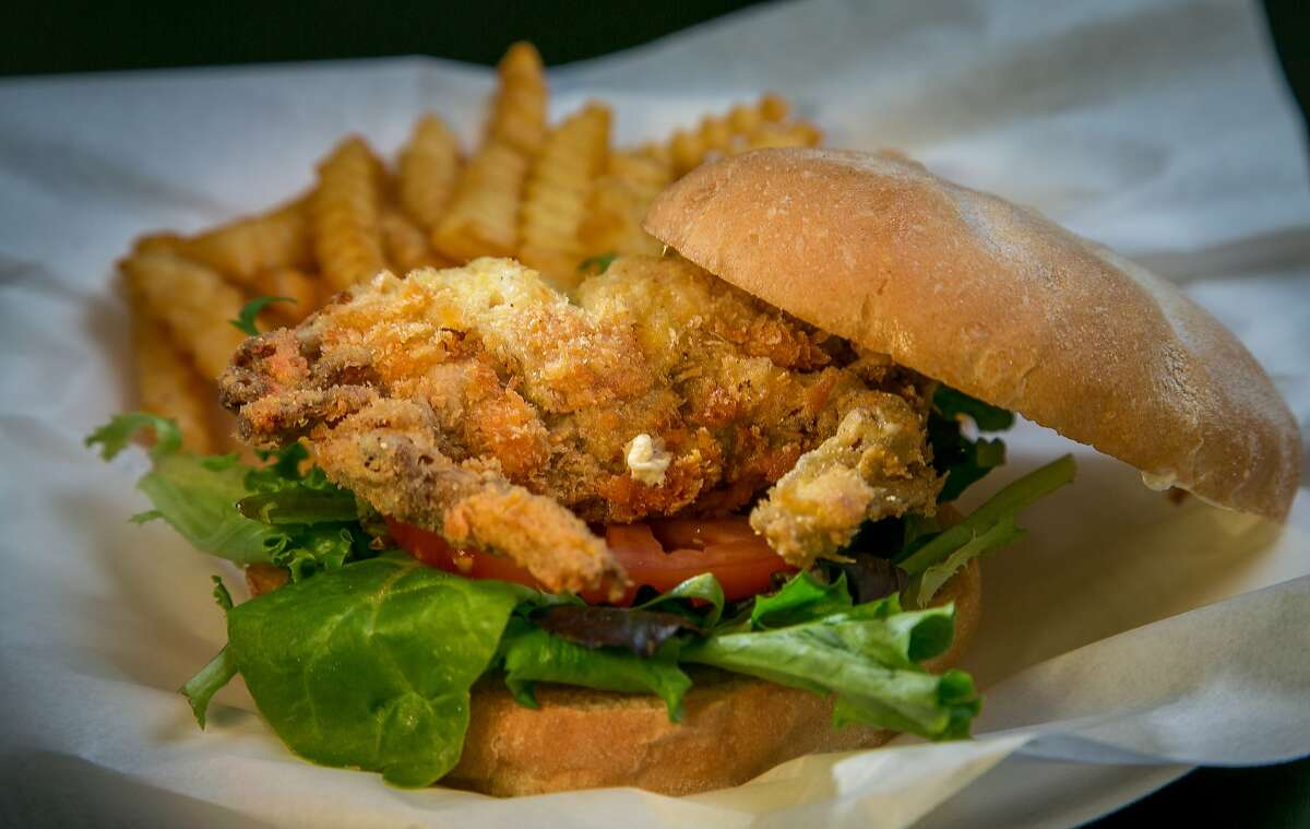 Basa Seafood Express specializes in fried dishes such as this soft-shell crab sandwich, above, served with a side order of fries.
