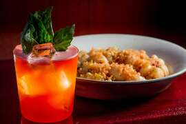 """The """"Trouble in Paradise"""" cocktail with the Lumaconi pasta at Tosca in San Francisco, Calif., is seen on Tuesday, March 26th, 2014."""