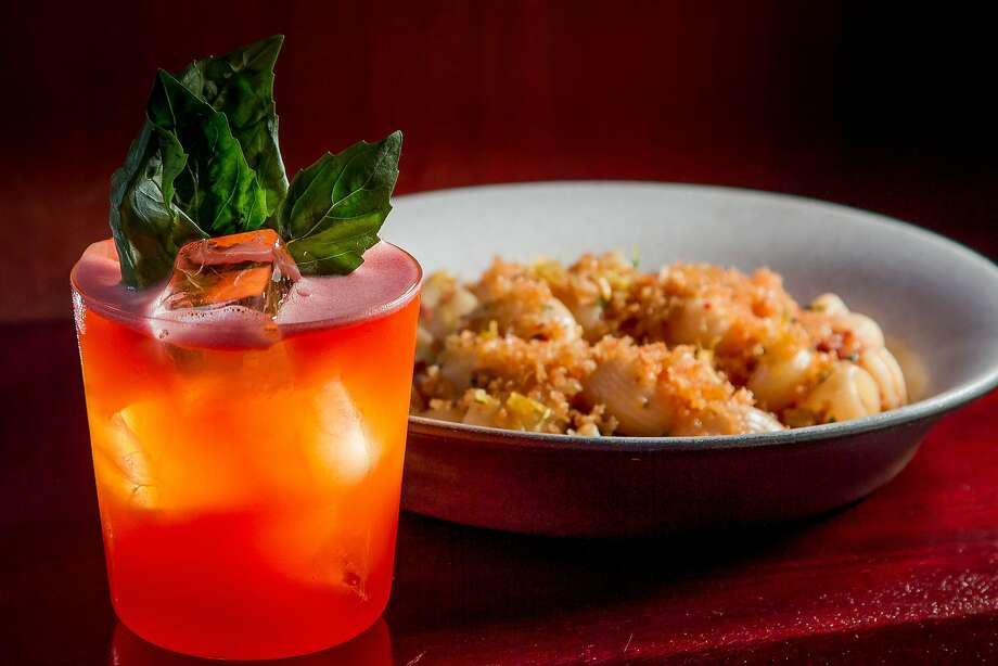 "The ""Trouble in Paradise"" cocktail, which mixes bourbon with Campari and black pepper, served with the Lumaconi pasta at Tosca in North Beach. Photo: John Storey, Special To The Chronicle"