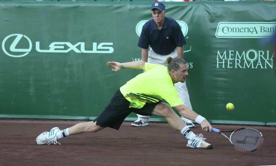 4/7/14: Alex Bogomolov Jr. (RUS) returns a shot against Sam Querrey (USA)  on day 1 at the U.S. Men's Clay Court Championship at River Oaks in Houston, TX. Querrey won 6-4,7-6. Photo: Thomas B. Shea / © 2014 Thomas B. Shea